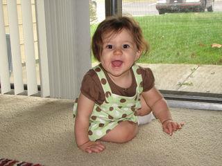 Kara in brown and green dress