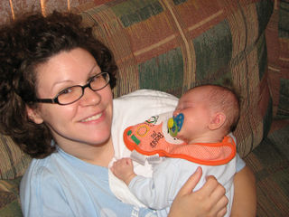 Frema with baby Danny sleeping