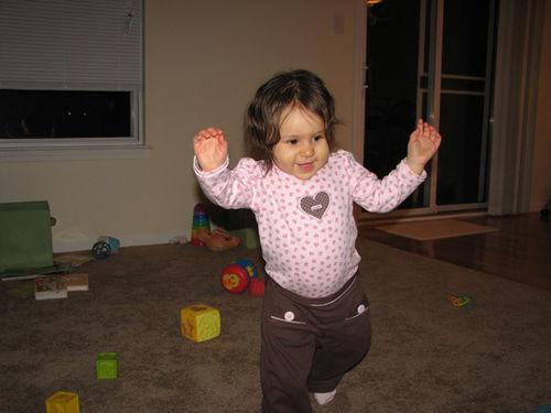 Kara running in living room
