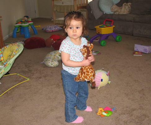 Kara holding giraffe living room