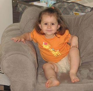 Kara orange shirt smiling