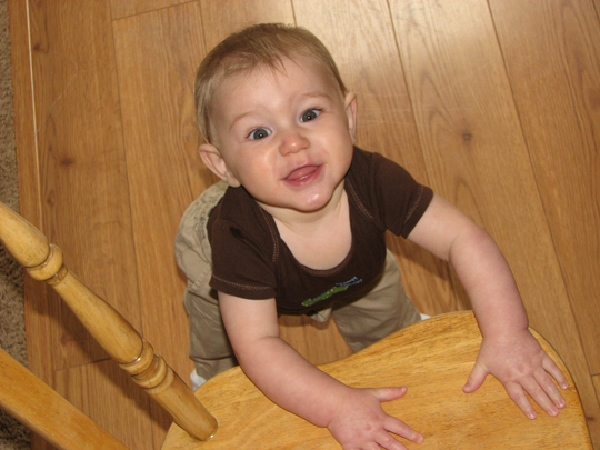 Nathan 7 months standing on chair