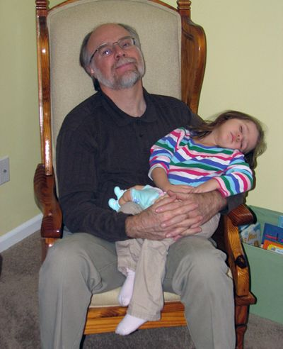 Kara 2 years napping with Grandpa